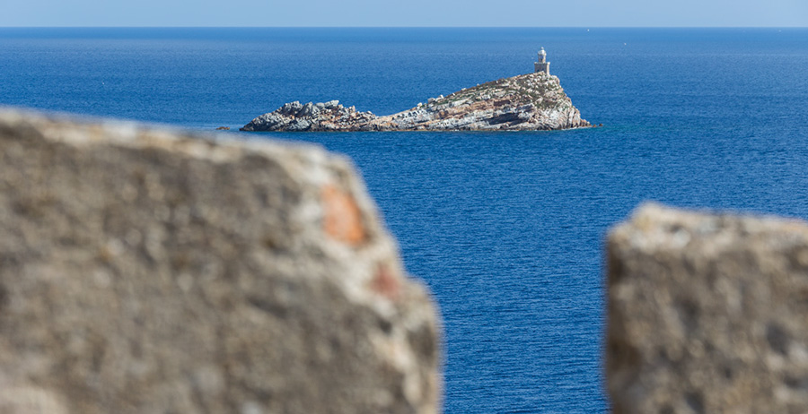 """Portoferraio Elba Island - lighthouse on """"Scoglietto"""" seen by the journey of rounds of strong star"""